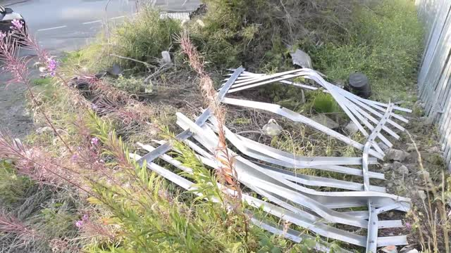 Damage caused to a steel palisade fence by a car in Middlesbrough